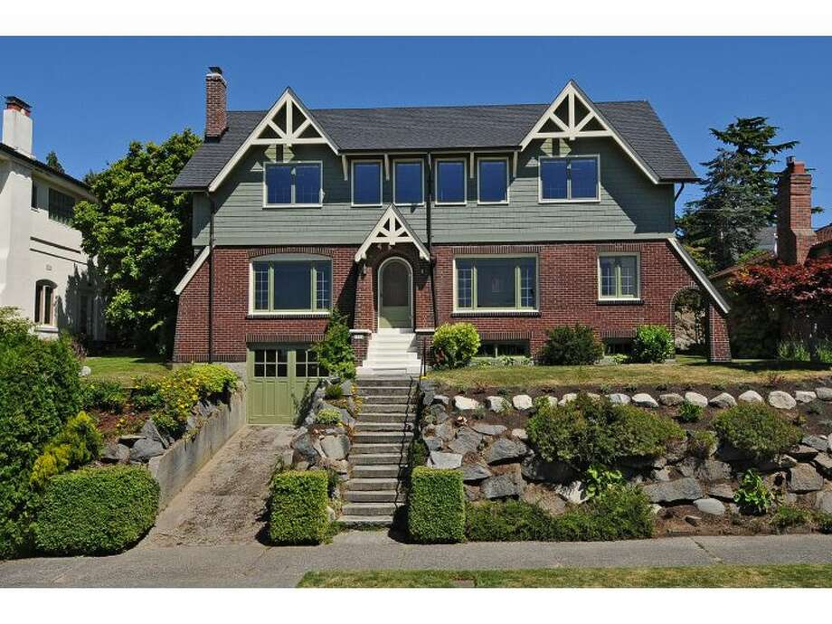 Here's a big, unique 1931 house in West Seattle with tons of character and mountain and sound views. The house is 3,700 square feet, with four bedrooms, 2.75 bathrooms, a family room, radiators, and exposed wood moldings and picture rails. It sits on a 6,000-square-foot lot at 1914 48th Ave. S.W. and is listed for $965,000. (Listing: www.windermere.com/index.cfm?fuseaction=listing.listingDetailUpdated&listingID=130402648) Photo: Windermere Real Estate