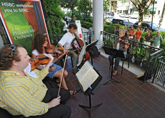 "A string quartet comprised of musicians from The Philadelphia Orchestra presents a free ""Pop-Up"" concert on the porch at Maestro's Restaurant on Broadway in Saratoga Springs, N.Y.  on Thursday, July 28, 2011. From left,  Jason DePue, violin, Charlene Kwas, violin, Robert Cafaro, cello, and Judy Geist, viola. (Lori Van Buren / Times Union) Photo: Lori Van Buren"