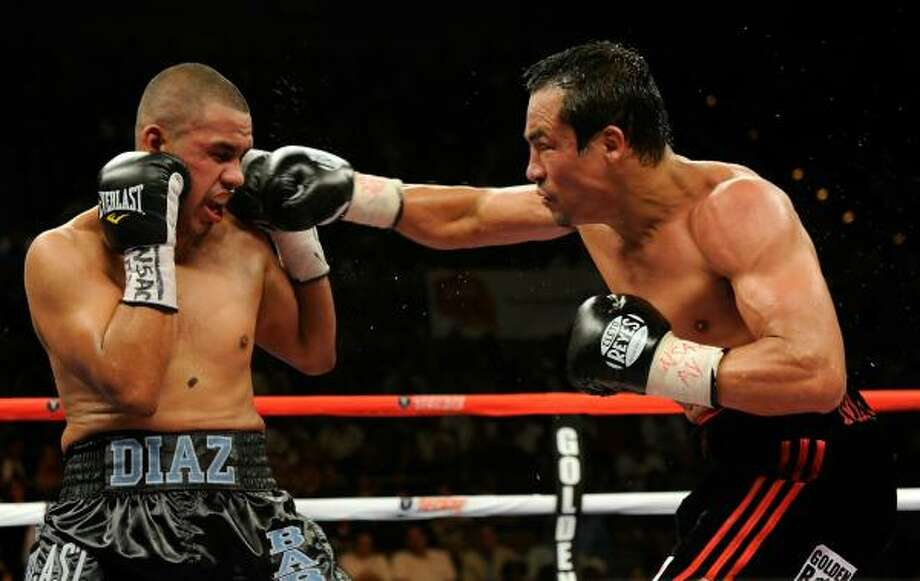 July 31, 2010: In what would be his final fight, Diaz, left, loses a 12-round unanimous decision to Mexican legend and WBA/WBO lightweight champion Juan Manuel Marquez at the Mandalay Bay Events Center in Las Vegas. Photo: Ethan Miller, Getty Images