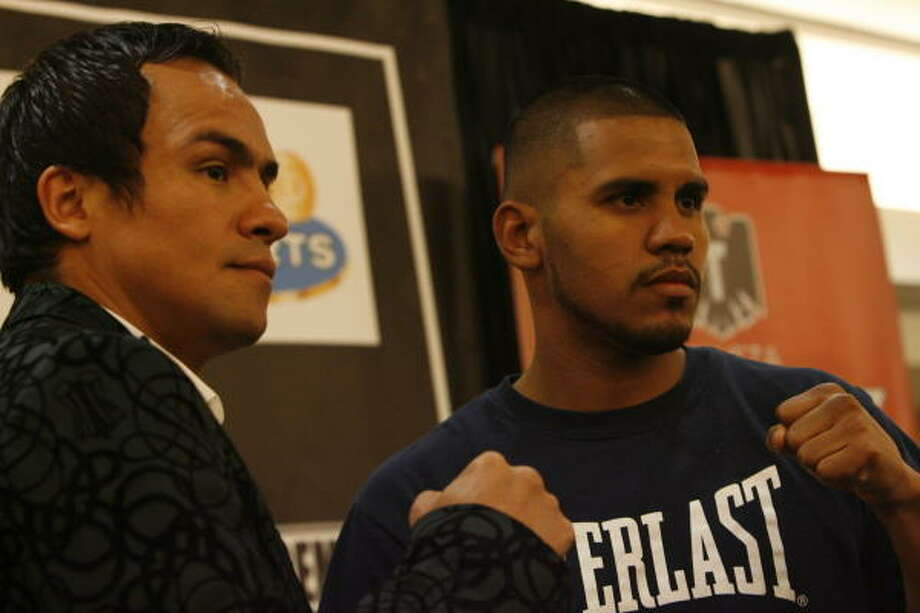 Jan. 8, 2009: Lightweight world champion Juan Manuel Marquez, left, squared off with Juan Diaz at a news conference before their February fight at Toyota Center. Photo: Julio Cortez, Chronicle