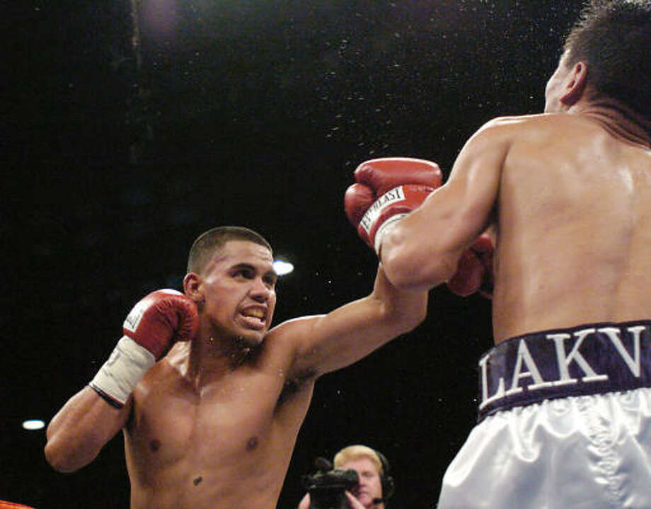 July 17, 2004:Juan Diaz wins his first world title, taking the WBA lightweight belt with a 12-round decision over Lakva Sim of Mongolia at Reliant Center. Photo: Dave Rossman, FOR THE CHRONICLE