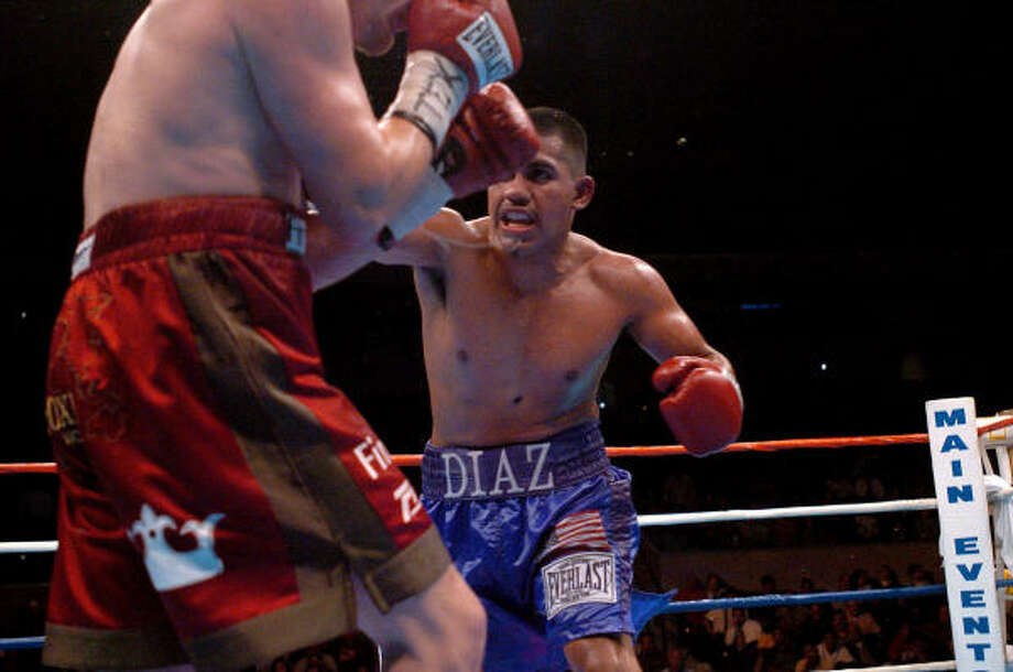 Nov. 11, 2004:Diaz, right, goes after Julien Lorcy during their WBA Lightweight title fight. Diaz defeated the veteran Lorcy via unanimous 12-round decision to retain his title at the SBC Center in San Antonio. Photo: SAN ANTONIO EXPRESS-NEWS