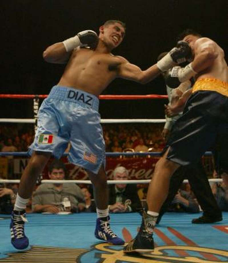 Nov. 22, 2003:Diaz blasts Joel Perez with a technical knockout in six rounds at Reliant Center for his 23rd straight win. Photo: Chronicle