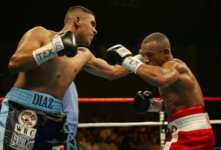 July 19, 2003: Diaz jabs the face of Francisco Lorenzo at Reliant Center. Diaz won a 10-round unanimous decision and remained perfect at 22-0. Photo: James Nielsen, Chronicle
