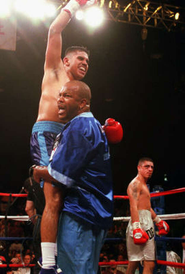 Oct. 19, 2002: Diaz is victorious against previously undefeated Roy Delgado at Reliant Park. Diaz won via 6th-round TKO, raising his record to 18-0. Photo: Chronicle