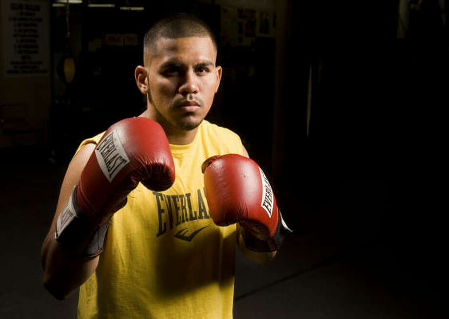 "Juan ""Baby Bull"" Diaz made his professional boxing debut when he was 16 years old. In 10 years, he finished 35-4 with 17 knockouts and became the WBA, WBO and IBF world lightweight champion. While a pro, he also graduated from high school and got a degree from the University of Houston. Photo: Nathan Lindstrom, For The Chronicle"