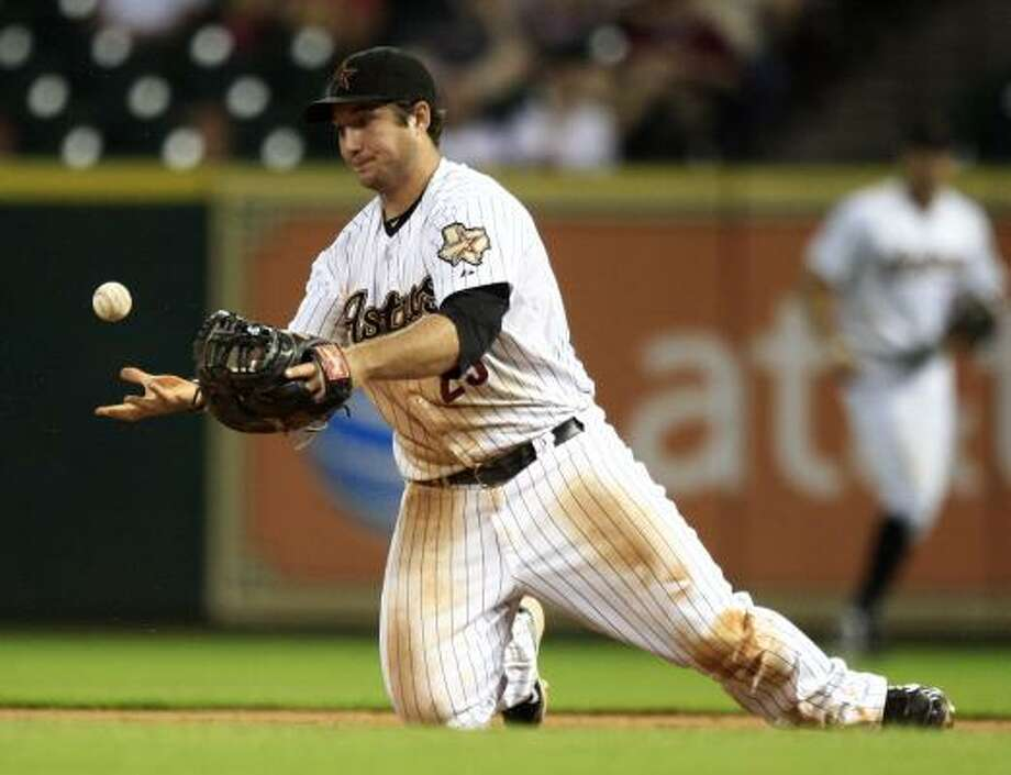 Astros first baseman Brett Wallace fumbles the ball after makeing a diving stop. Photo: Bob Levey, Getty