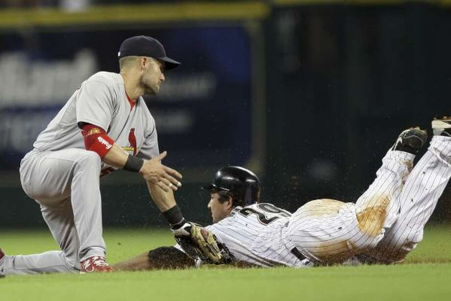 Cardinals second baseman Skip Shumaker tags out Brett Wallace as he tries to steal second base in the fourth inning. Photo: Bob Levey, Getty