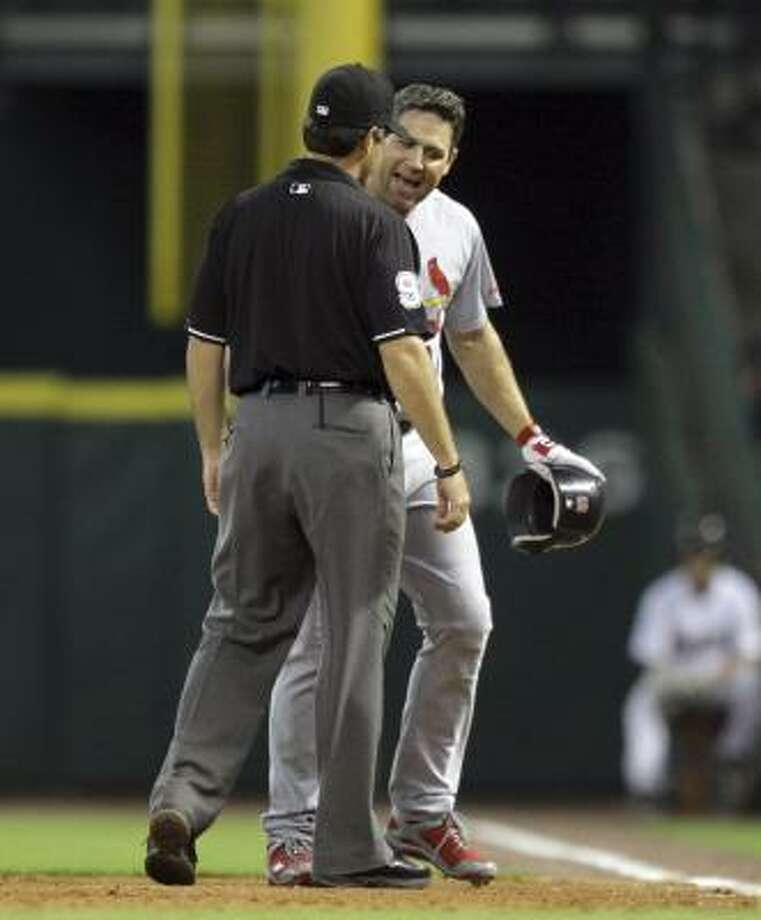 Lance Berkman of the Cardinals argues with first base umpire James Hoye after he was called out. Photo: Bob Levey, Getty