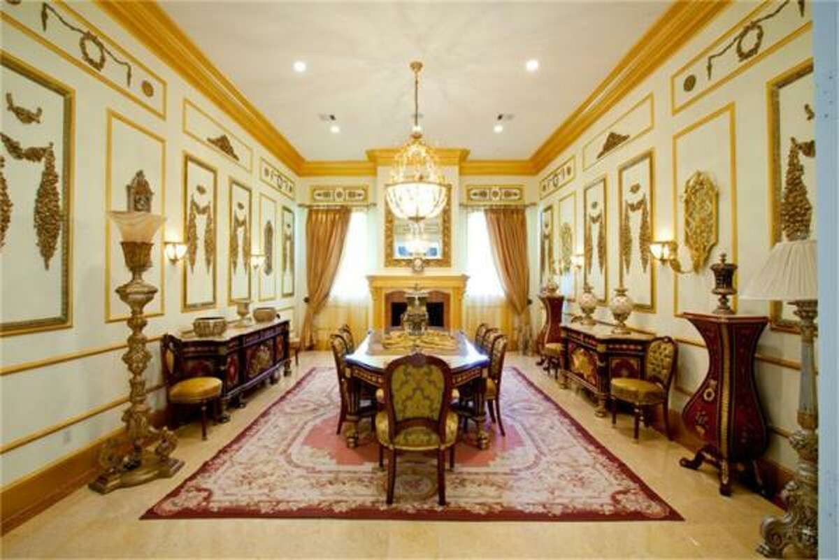 The ornate formal dining room of the house.There are three kitchens on the property, with a breakfast area and a list of appliances that features a double oven, freestanding range, microwave, dishwasher and icemaker. Other key rooms include a den, formal living room and dining room, game room and a library/study. In addition to the two staircases, there is also an elevator. The main house offers high ceilings, four fireplaces and a variety of flooring styles, including carpet, stone and marble.