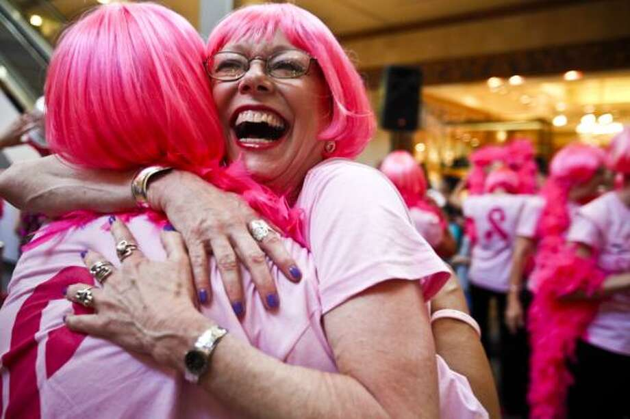 "Peggy Hinojosa, right, hugs others after dancers and cancer survivors performed during a ""flash mob"" featuring Gloria Gaynor June 4, 2011 in Houston at the Galleria. The Lester and Sue Smith Foundation, in conjunction with www.pinkwell.org, presented a dance tribute celebrating National Cancer Survivors Day on June 4, 2011 12:30 PM at the Houston Galleria. This unprecedented six-minute-long event featured more than 250 women, including 100 cancer survivors, performing a professionally choreographed routine, dancing to the iconic disco-era song, I Will Survive performed live by the legendary diva of disco, Gloria Gaynor. Photo: Eric Kayne, For The Chronicle"