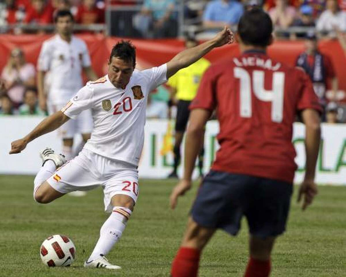 Spain 4 - U.S. 0 Eric Lichaj could only look on as Santiago Cazorla shoots and scores a goal during the U.S. and Spain friendly. Spain showed why it is the reigning World Cup champion by easily defeating the U.S.