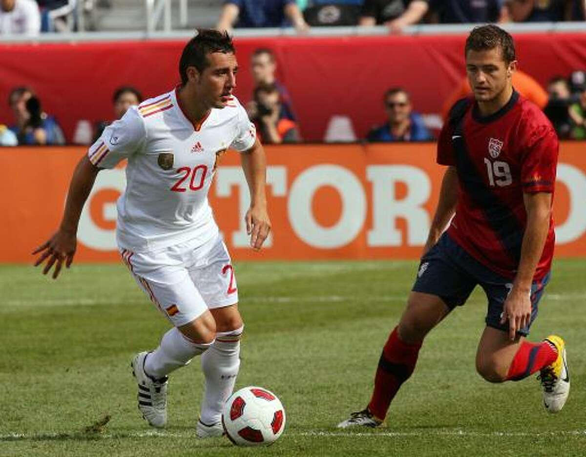 Santiago Cazorla (20) and Robbie Rogers (19) during the friendly international.
