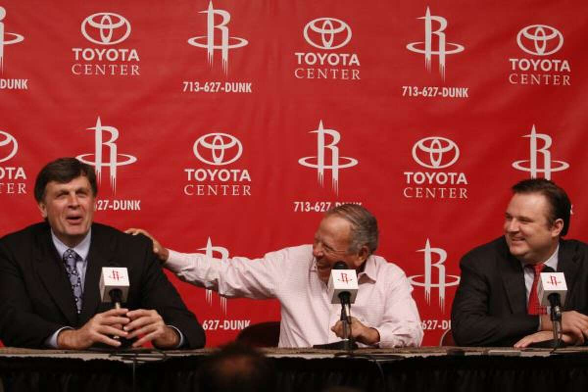 New Rockets head coach Kevin McHale, Rockets owner Les Alexander and general manager Daryl Morey speak at a press conference Friday at the Toyota Center.