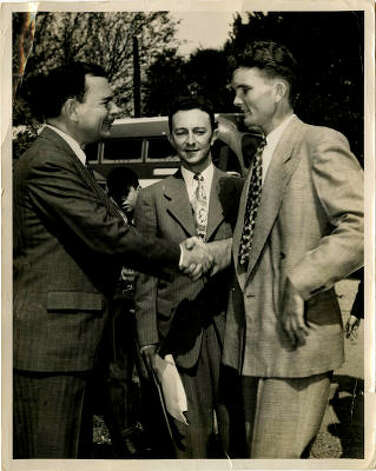 "Leon Hale with Gov. Thomas Dewey. On the back of the photo Hale wrote: ""I went to Dewey's farm in Pawling, NY in '48 when everybody thought he would be elected president."" Hale was the farm and ranch editor at the Houston Post then.  credit: Leon Hale Papers, Courtesy of Special Collections, University of Houston Libraries."