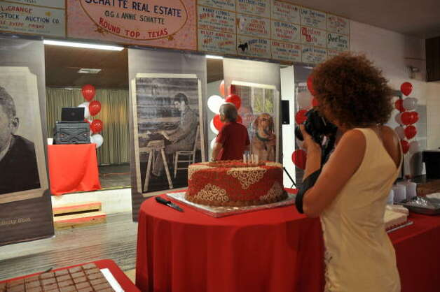 The cake and the scene at the Rifle Association Hall in Round Top. Photo: Melissa Ward Aguilar, Chronicle