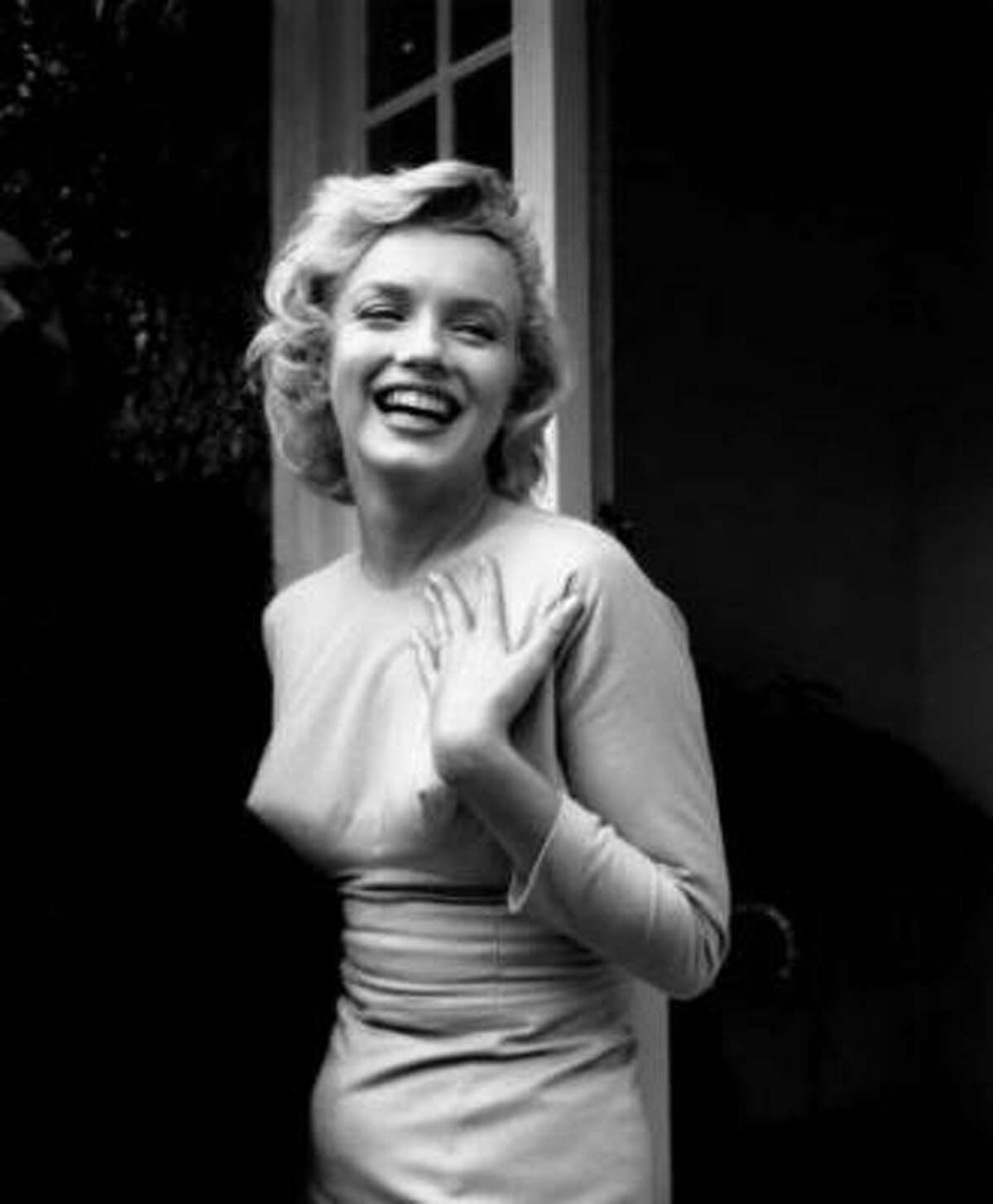 Monroe outside her home at Englefield Green, England on July 17, 1956.