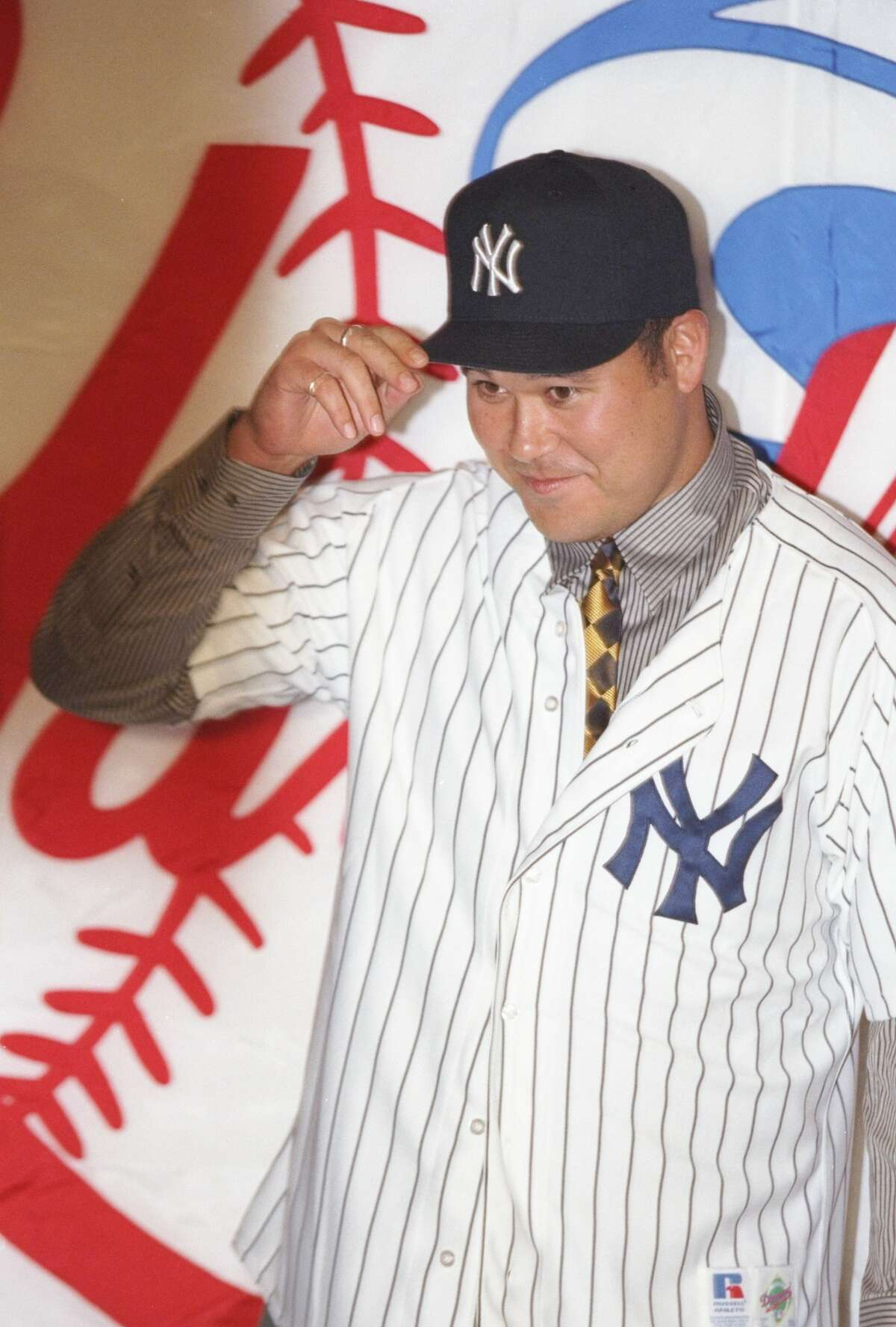 30 May 1997:  Pitcher Hideki Irabu of the New York Yankees holds cap during a press conference at Yankee Stadium in Bronx, New York. Mandatory Credit: Al Bello  /Allsport