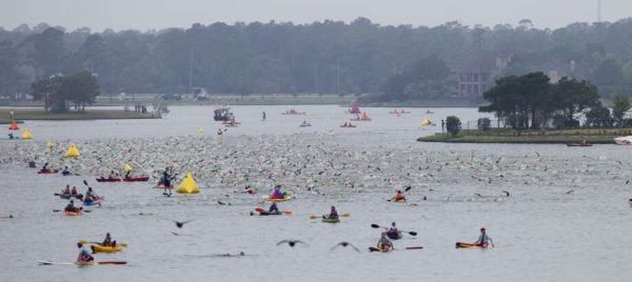 Competitors begin the swim portion. Photo: Brett Coomer, Chronicle