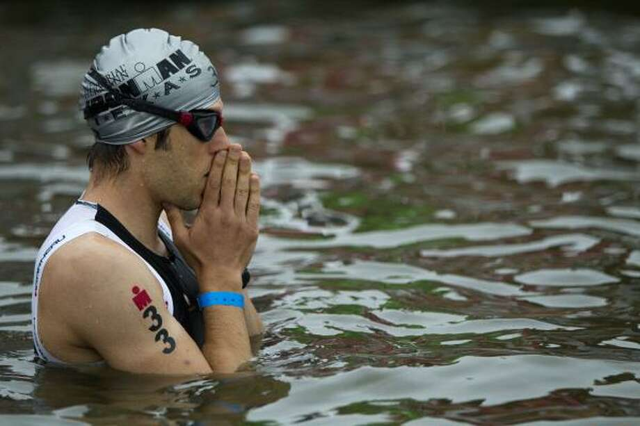 Jerome Bresson, of Canada, prepares to start the swim portion. Photo: Brett Coomer, Chronicle