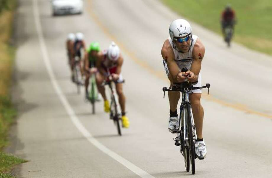 Eneko Llanos, of Spain, rides in the lead pack during the cycling portion. Photo: Brett Coomer, Chronicle