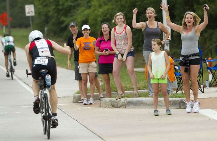 Fans cheer on cyclist Blaine Squires as he rides out of The Woodlands. Photo: Brett Coomer, Chronicle