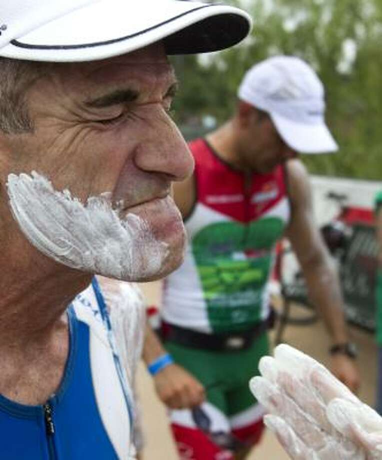 Rusty Robertson has sunscreen spread on his face as he gets ready to start his marathon. Photo: Brett Coomer, Chronicle