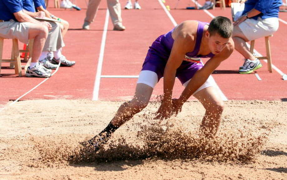 May 14: State trackAngelton's Trevor Henderson in the Long Jump