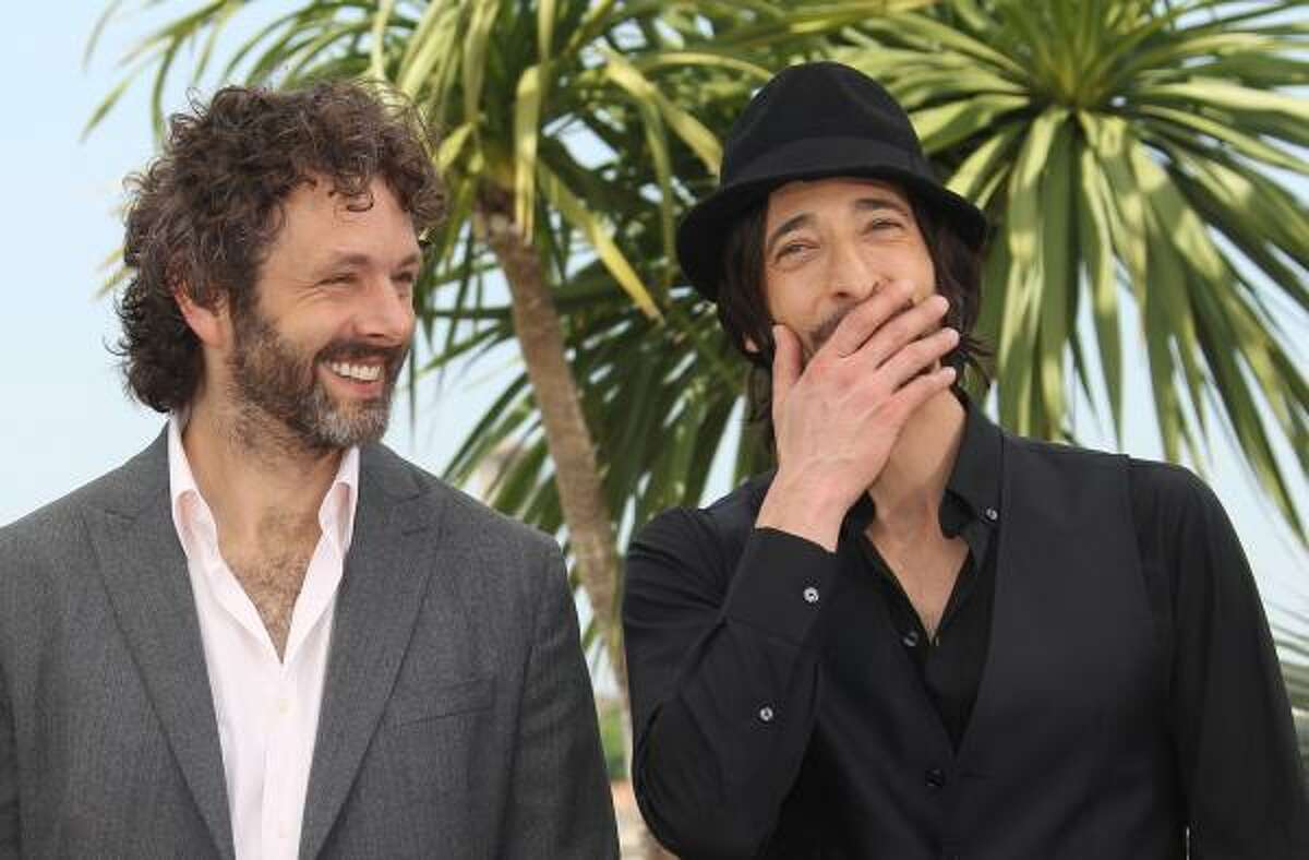 British actor Michael Sheen and American actor Adrien Brody pose during the photocall of 'Midnight in Paris' presented out-of-competition at the 64th Cannes Film Festival on May 11, 2011 in Cannes.