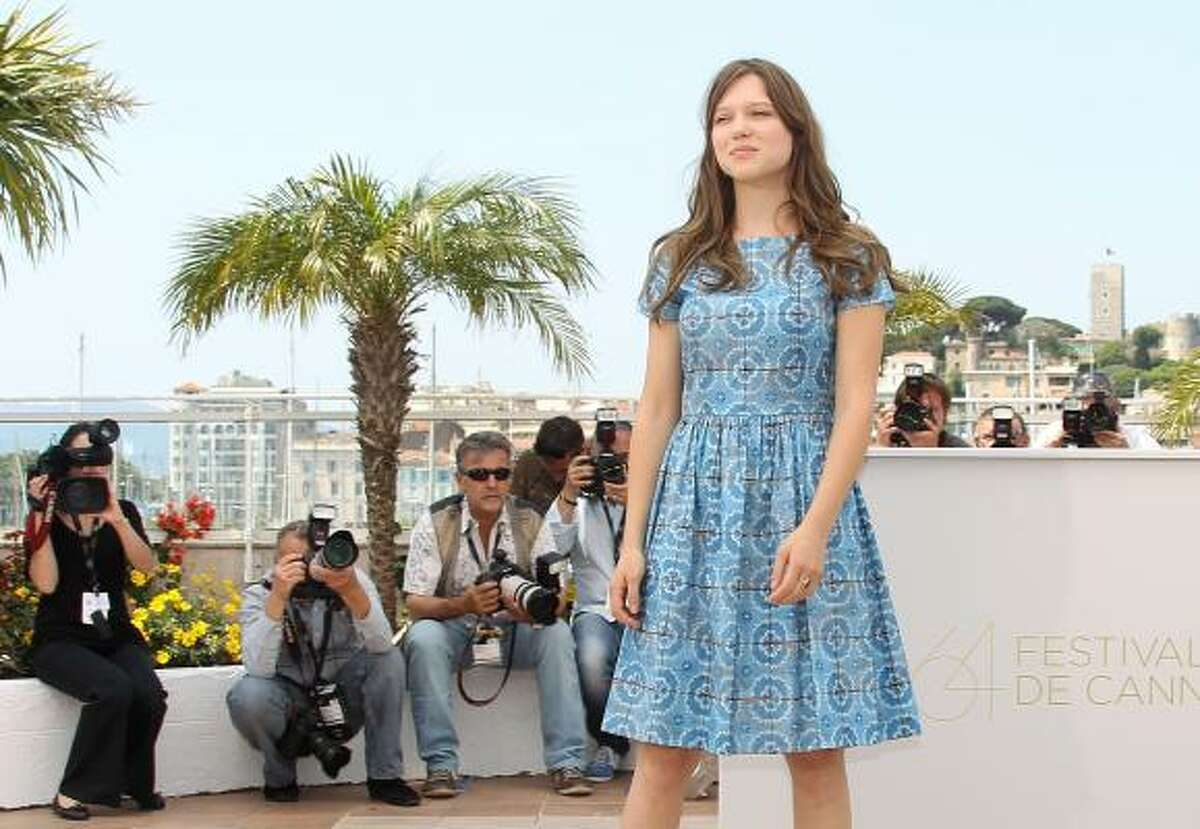 French actress Lea Seydoux poses during the photocall of 'Midnight in Paris' presented out-of-competition at the 64th Cannes Film Festival on May 11, 2011 in Cannes.