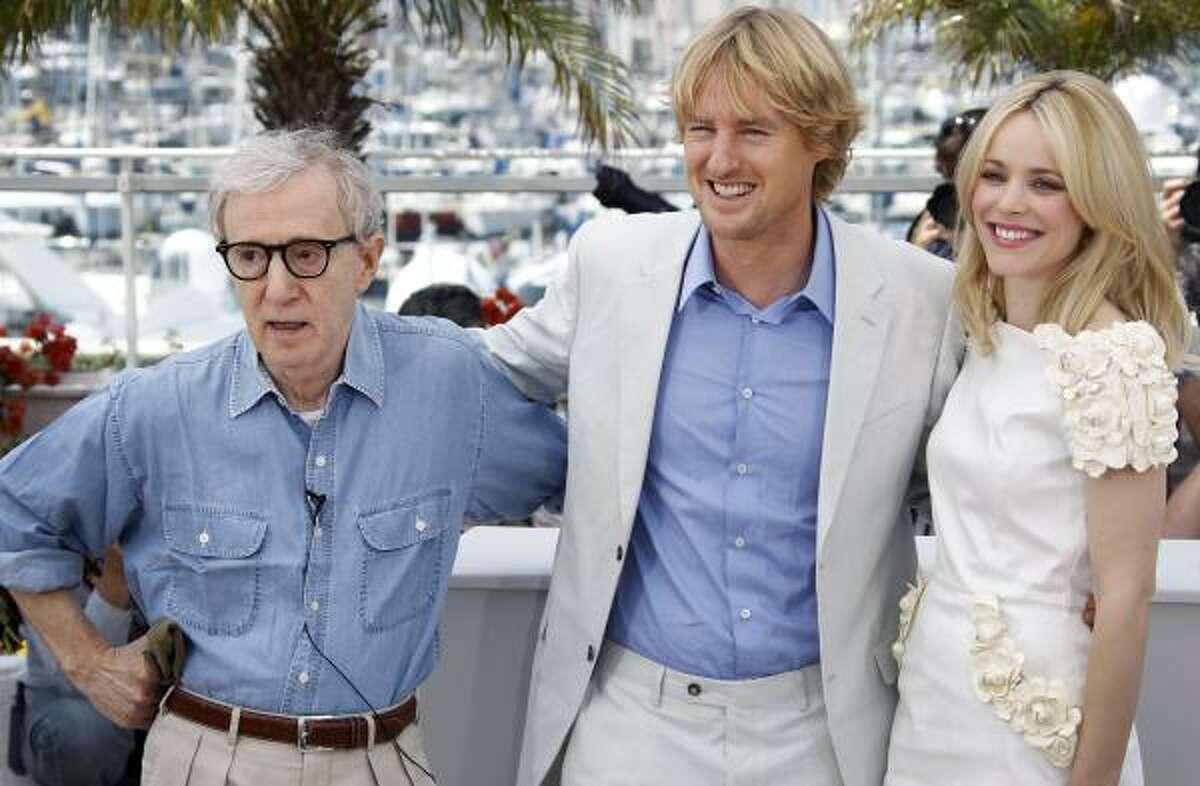 Director Woody Allen, left, actors Owen Wilson and Rachel McAdams pose during a photo call for 'Midnight in Paris,' at the 64th international film festival, in Cannes, southern France, Wednesday, May 11, 2011.