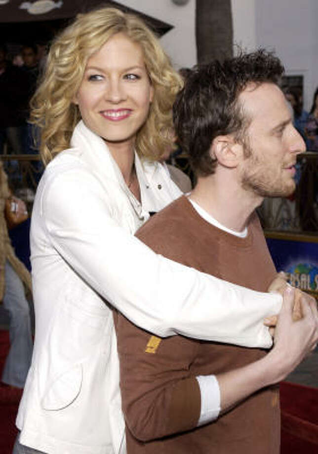 Jenna and Bodhi Elfman:Kids' names: Story Elias and Easton Quinn Photo: CHRIS WEEKS, AP