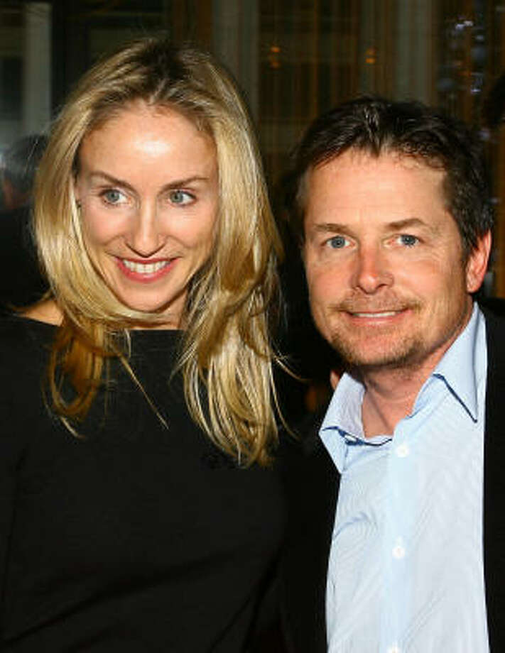 Michael J. Fox  and Tracy Pollan:Kids' names: Aquinnah, Schuyler, Sam and Esme. Photo: Scott Wintrow, Getty Images