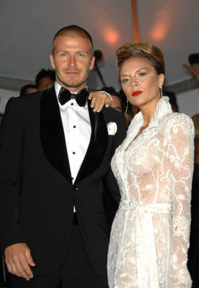 David Beckham and Victoria Beckham:Kids' names: Brooklyn, Romeo and Cruz Photo: Evan Agostini, AP