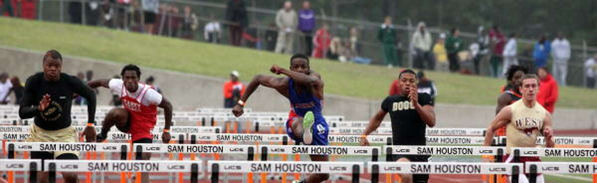 Kashmere's Michael Prejean, middle, made it to state in the 300-meter-110 hurdles.