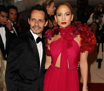Marc Anthony and Jennifer Lopez in Gucci Photo: Peter Kramer, Associated Press