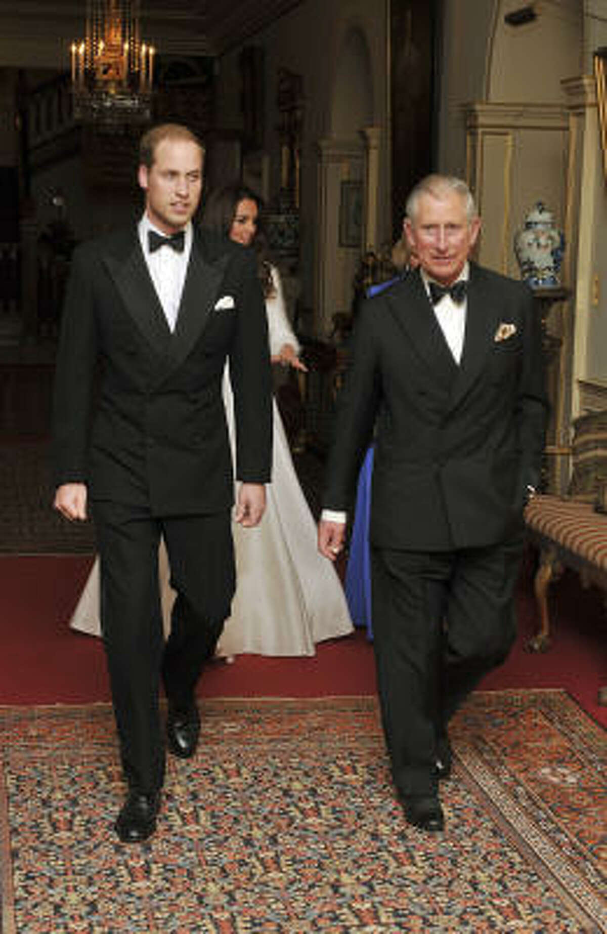 Prince William trades in his military ensemble for a dapper tux as he, his father, wife Kate, and step-mother Camilla leave for a post-wedding celebration at Buckingham Palace.