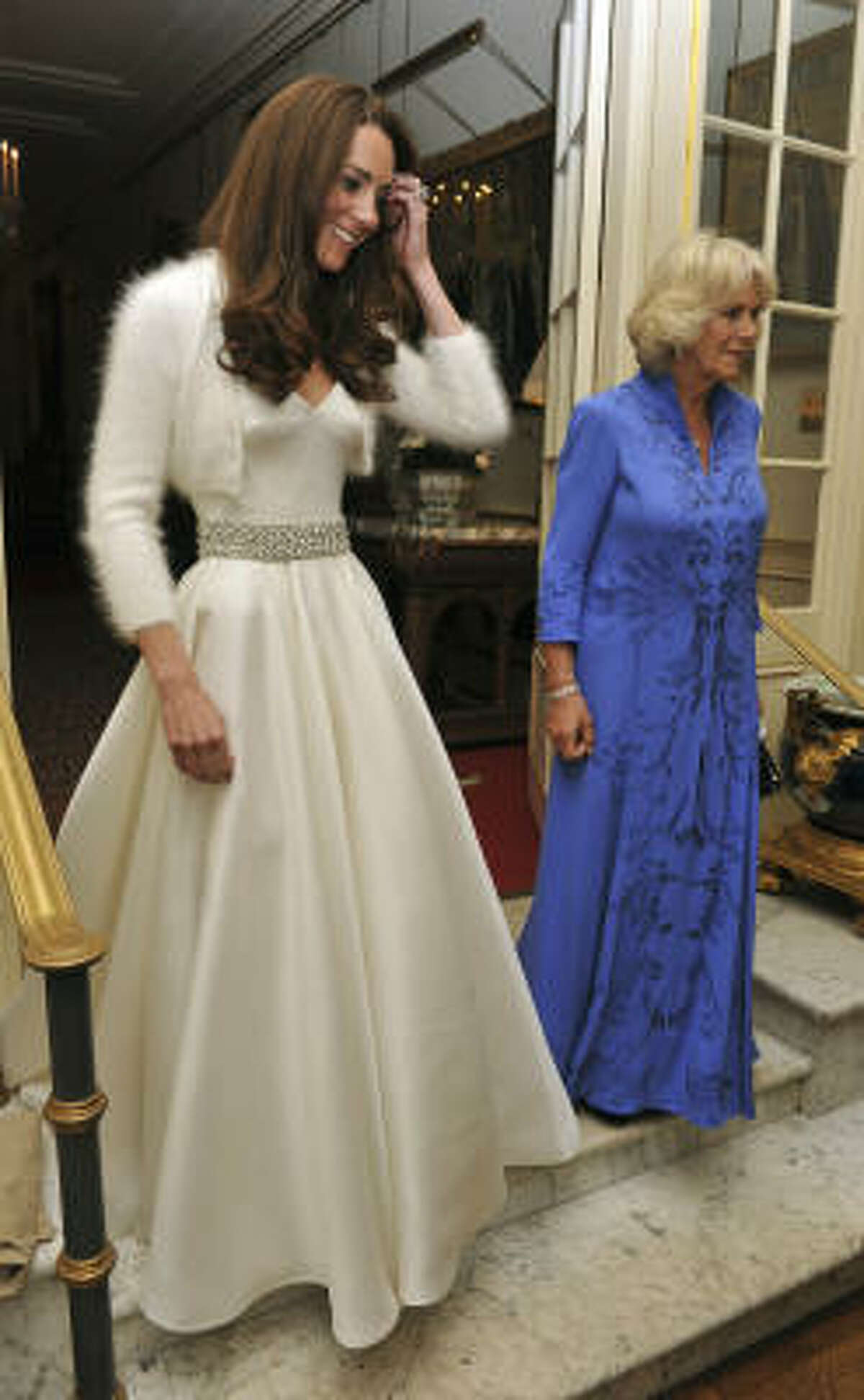 Meanwhile, Kate, the Duchess of Cambridge, dons an evening gown for the bash.