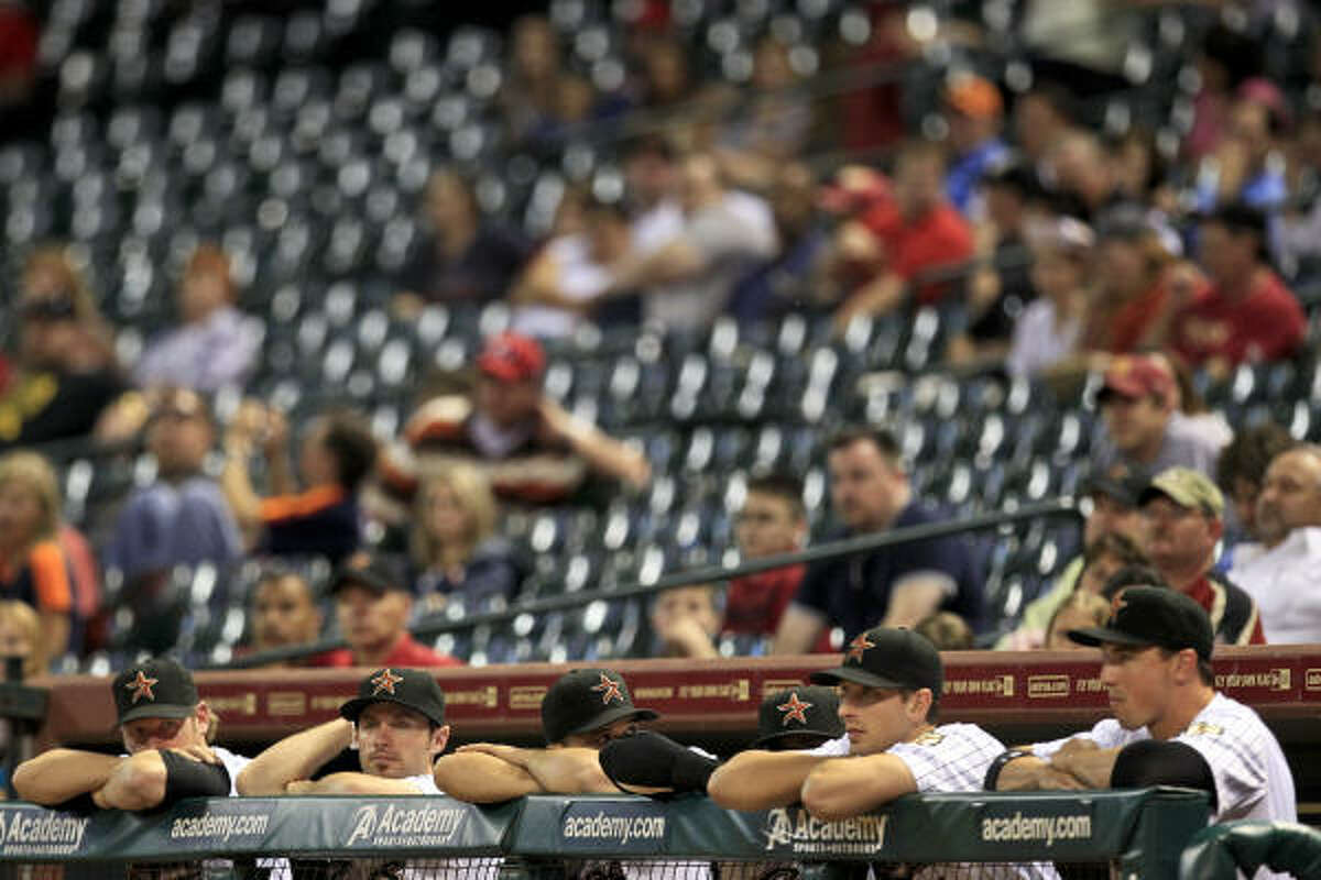 The Astros bench looks on in despair during the final minutes as the Cardinals put the finishing touches on their win.