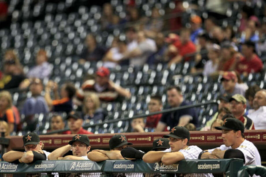 The Astros bench looks on in despair during the final minutes as the Cardinals put the finishing touches on their win. Photo: Michael Paulsen, Chronicle