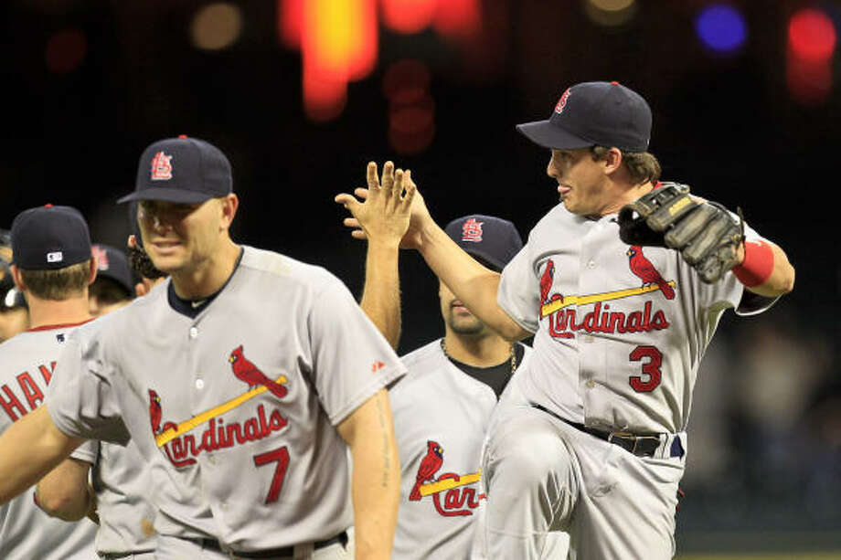 Cardinals shortstop Ryan Theriot (3) congratulates teammates after their win over the Astros. Photo: Michael Paulsen, Chronicle
