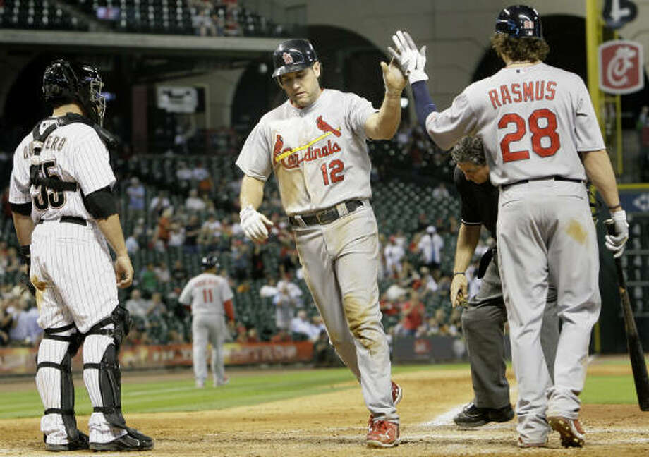St. Louis' Lance Berkman, center, high-fives Colby Rasmus after hitting a home run in the ninth inning. Photo: Cody Duty, Chronicle