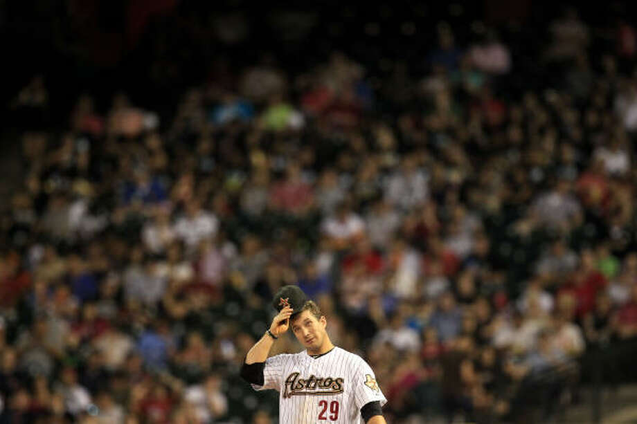 Astros first baseman Brett Wallace (29) scratches his head during the fourth inning. Photo: Michael Paulsen, Chronicle