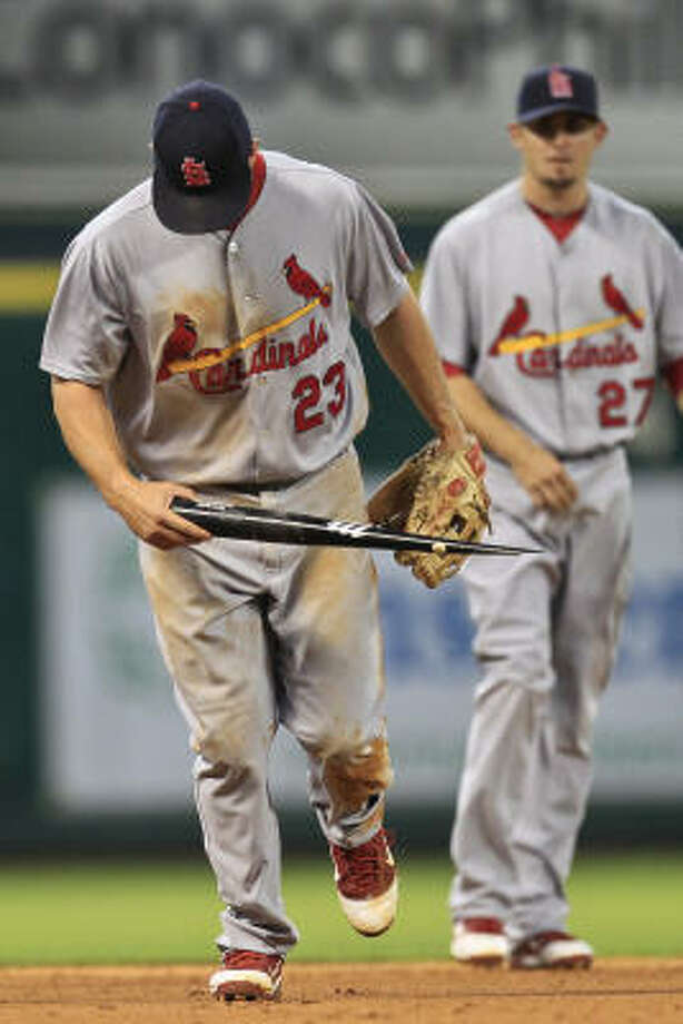 Cardinals third baseman David Freese (23) picks up a bat broken by Astros catcher Humberto Quintero during the fourth inning. Photo: Michael Paulsen, Chronicle