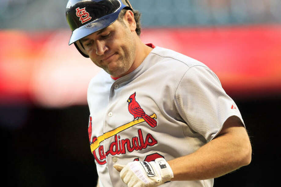 Cardinals right fielder Lance Berkman heads back to the dugout after hitting into a double play during the second inning. Photo: Michael Paulsen, Chronicle