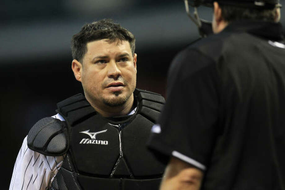 Astros catcher Humberto Quintero talks to home plate umpire Ed Rapuano during the fourth inning. Photo: Michael Paulsen, Chronicle