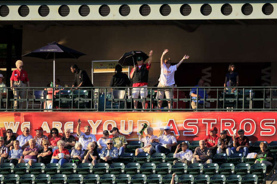 Fans take to their seats before the start of Thursday's game. Photo: Michael Paulsen, Chronicle
