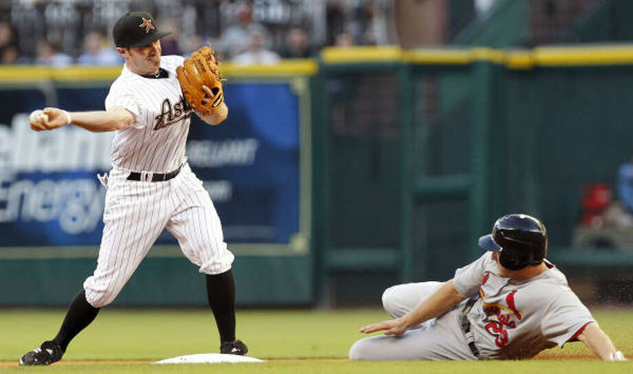 Astros second baseman Joe Inglett (3) throws a ball to first base as Cardinals' David Freese is out at second base on a double play in the first inning. Photo: Cody Duty, Chronicle