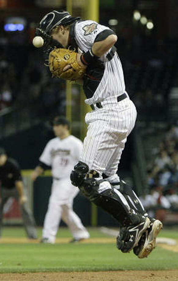Astros catcher J.R. Towles (46) jumps to stop a throw in the seventh inning. Photo: Cody Duty, Chronicle