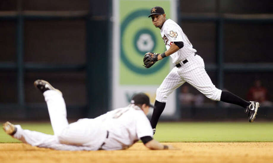 Astros shortstop Angel Sanchez, right, chases down a hit after third baseman Chris Johnson came up short on the play. Photo: Cody Duty, Chronicle